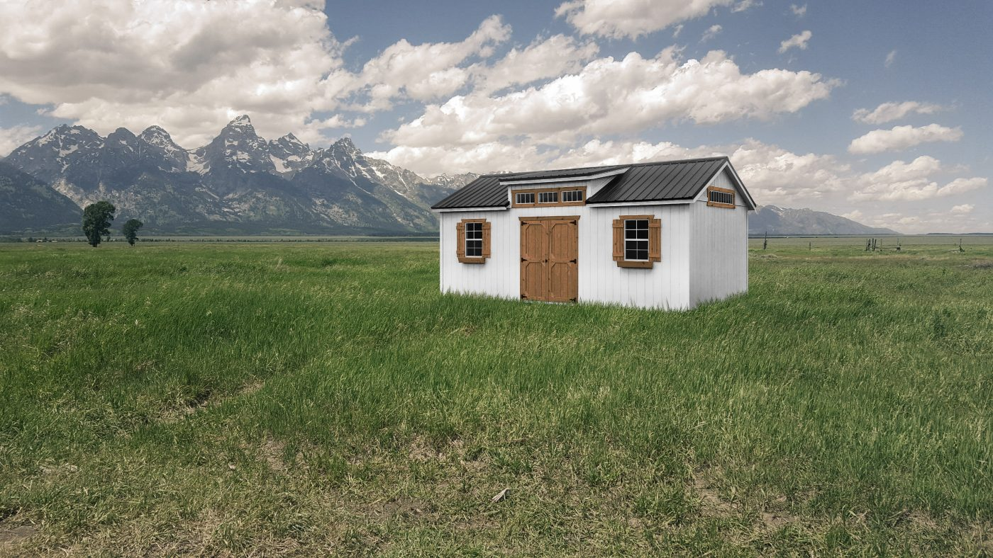 A Durable Studio Shed With a Double door and 2 Windows on the side with a Dormer in Canon City